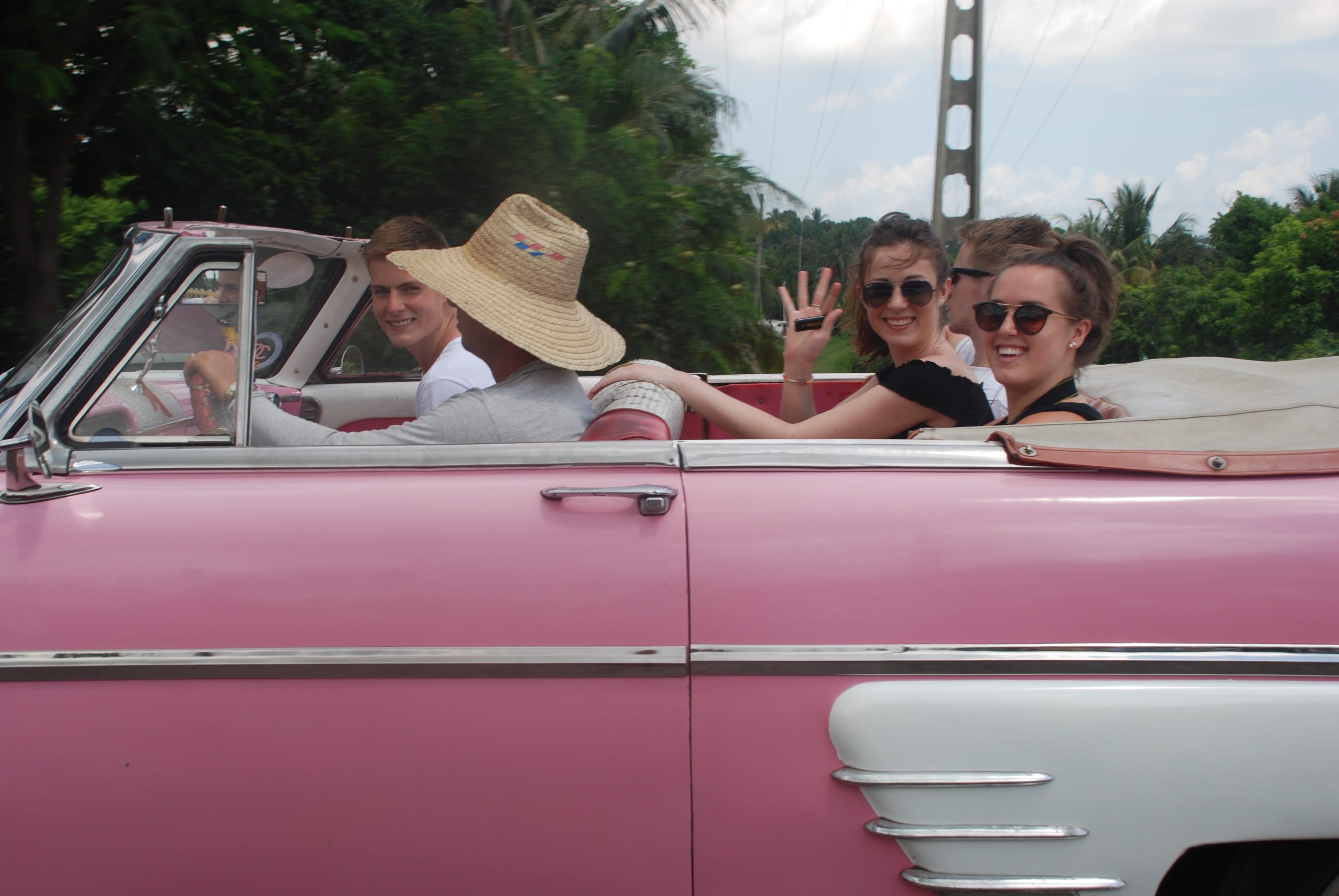 Cuba, kids in pink car